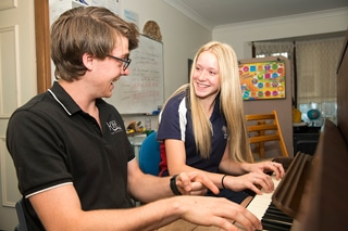 Playing Piano - Find A Tutor in Coffs Harbour, NSW